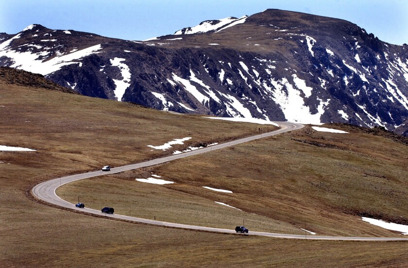 Trail Ridge Road snakes along the spine of America as it winds through the tundra at 12,000 feet in Rocky Mountain National Park, Colorado.