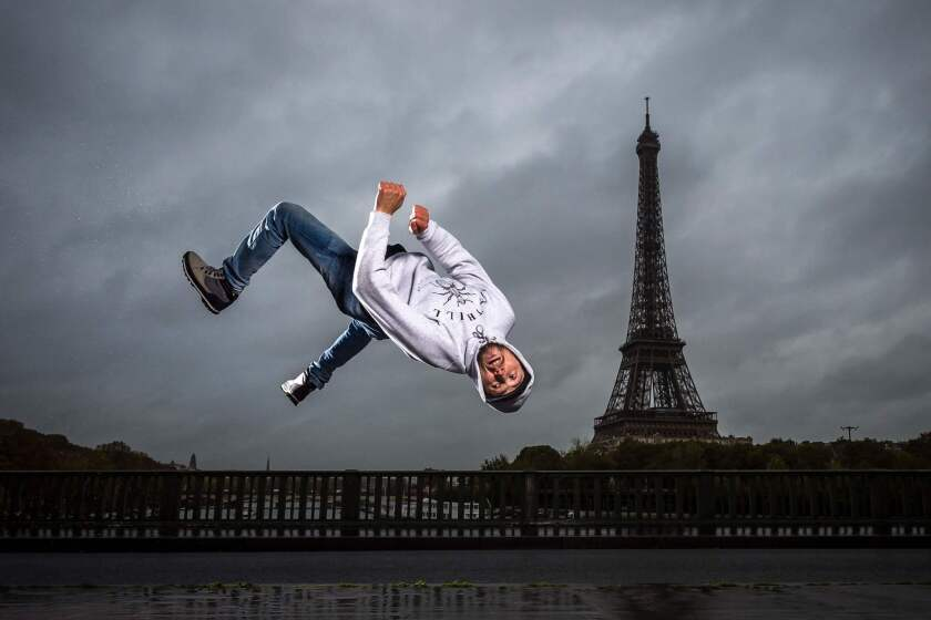 """Sofiane, or B-boy Soso, from Melting Force dance crew poses in front of the Eiffel Tower on Bir-Hakeim bridge in Paris. - Breakdancing, surfing, climbing and skateboarding : the Olympic Games Organizing Committee (COJO) for Paris-2024 will unveil on February 21, 2019 a list of """"guest sports"""" for the Paris-2024, which still needs to be validated by the International Olympic Committee (CIO), it was announced on February 20."""