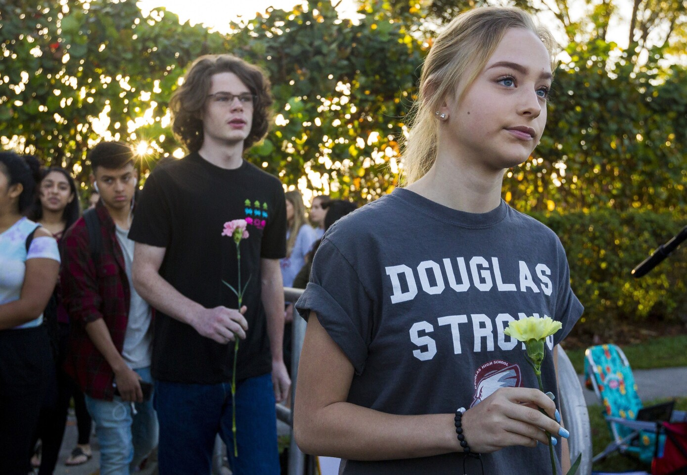 Students were greeted by supporters, signs and flowers as they returned to class at Marjory Stoneman Douglas High School on Wednesday.