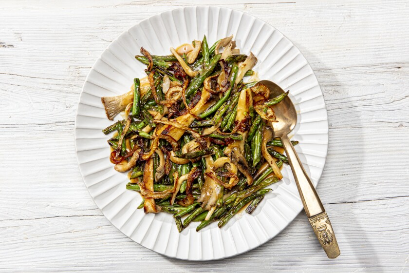 LOS ANGELES, CALIFORNIA, Nov. 4, 2020: Dry-Fried Green Beans and Mushrooms with Crispy Onions for LA Times Cooking section's Thanksgiving 2020 story and recipes by Ben Mims, photographed on Wednesday, Nov 4, 2020, at Proplink Studios in Arts District Los Angeles. (Photo / Silvia Razgova, Food styling / Ben Mims, Prop styling/ Kate Parisian) ATTN: 644074-la-fo-new-thanksgiving-2020