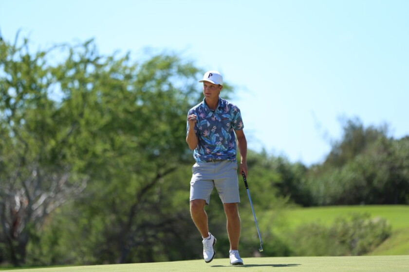 Pepperdine's William Mouw reacts after making the winning putt Feb. 8, 2020, at the Amer Ari Invitational in Hawaii, where he notched his first college individual title.