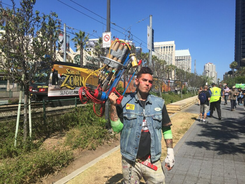"""David Arambula stands with his homemade """"Roman candle gun"""" outside the San Diego Convention Center during Comic-Con."""