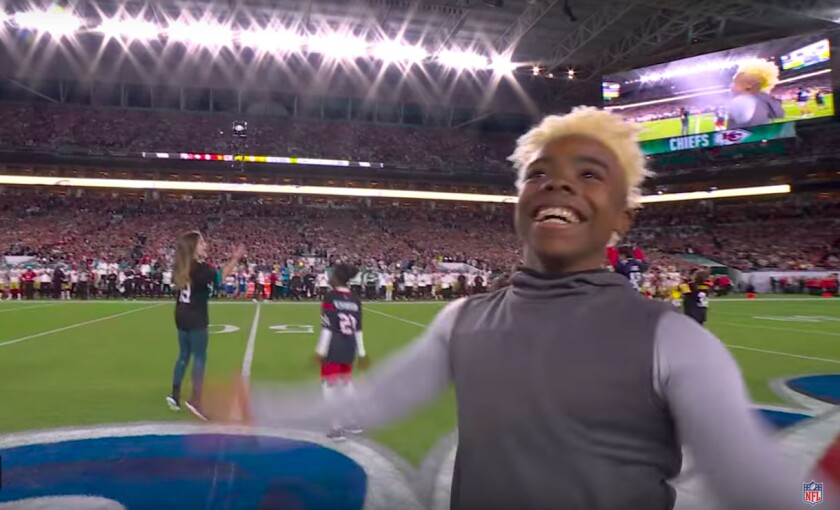 """Super Bowl LIV got off to a memorable start with the NFL's """"Take It To The House Kid"""" commercial to deliver the game ball in Miami Gardens, Fla."""