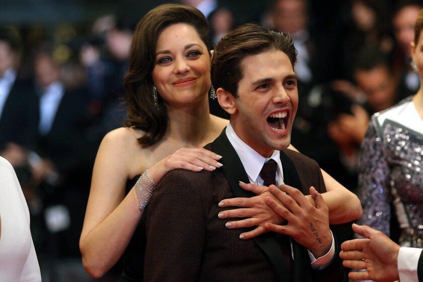 "Marion Cotillard and Xavier Dolan at the Cannes premiere of ""Juste la Fin du Monde."""