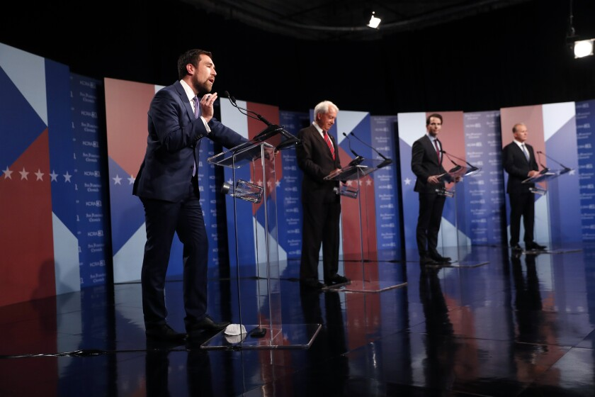 Recall candidates on the debate stage.