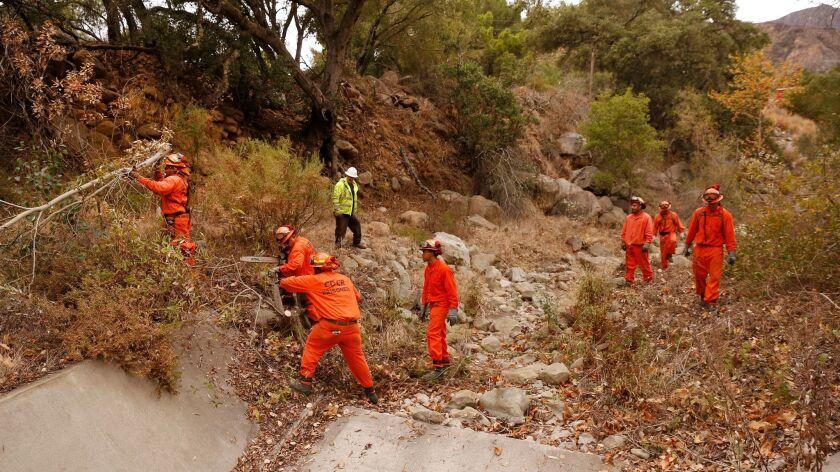 Work crews clear Toro Canyon Creek below the Thomas fire burn area in the Santa Ynez Mountains above Montecito and Carpinteria