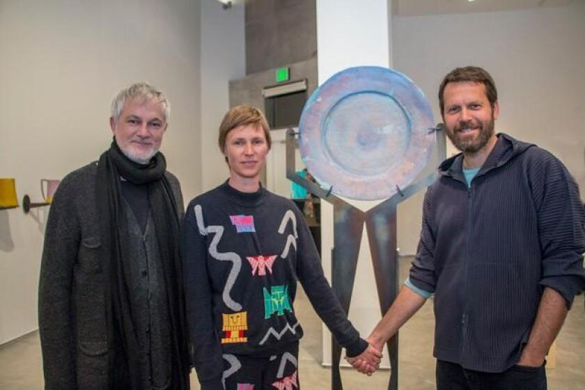 At the opening, artist Francis Upritchard poses with her NYC gallerist Christoph Gerozissis and her husband Martino Gamper in front of her polymer and steel 'Lake Plate' at at Lux Art Institute.