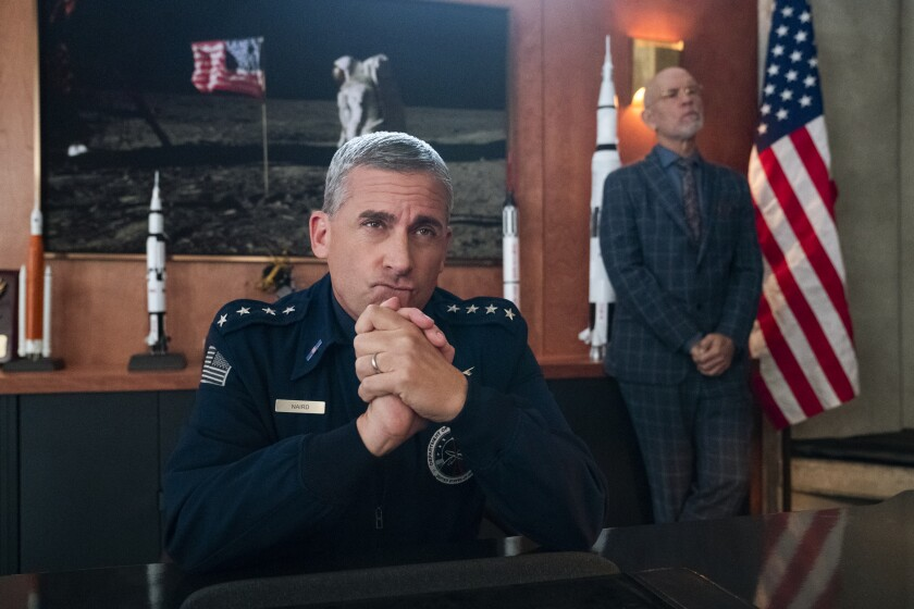 "Steve Carell, left, and John Malkovich star in the Netflix series ""Space Force."""