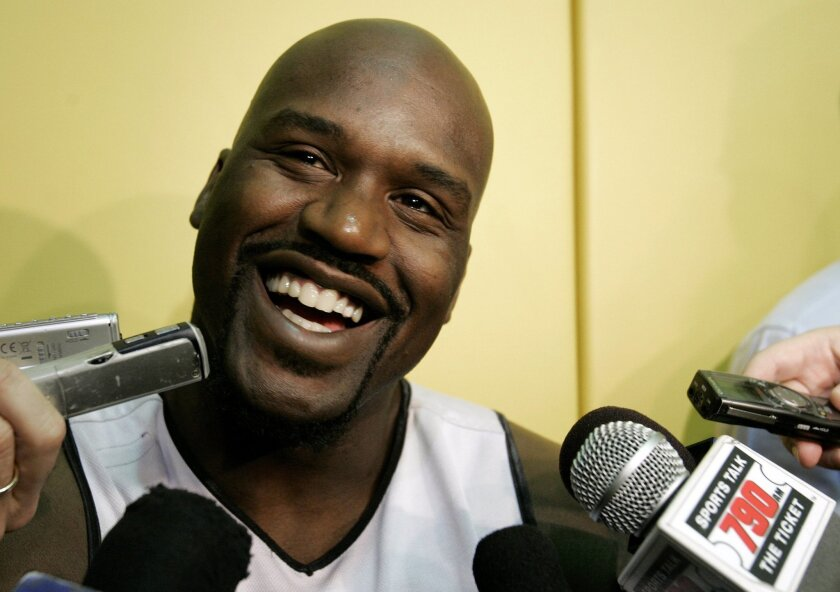 FILE - This April 19, 2007, file photo shows Miami Heat center Shaquille O'Neal talking to the news media following a team basketball practice in Miami. This year's Hall of Fame class includes a star-studded field of potential finalists, including Shaquille O'Neal, Yao Ming and Allen Iverson. That