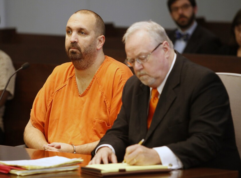 Murder defendant Craig Stephen Hicks, 46, left, listens while his co-defense counsel Terry Alford makes notes during a death penalty hearing for Hicks in Durham, N.C., on April 6.