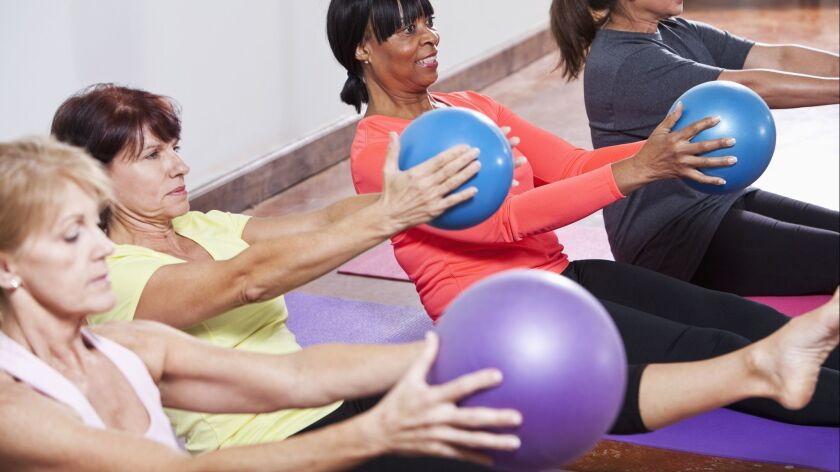Exercise class using fitness balls