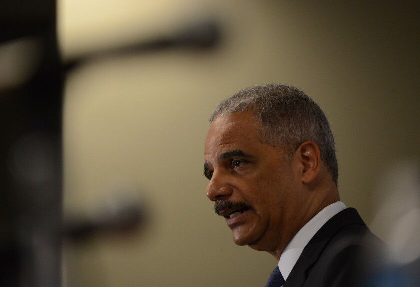 Outgoing Atty. Gen. Eric Holder speaks at the Voting Rights Brain Trust event in Washington.