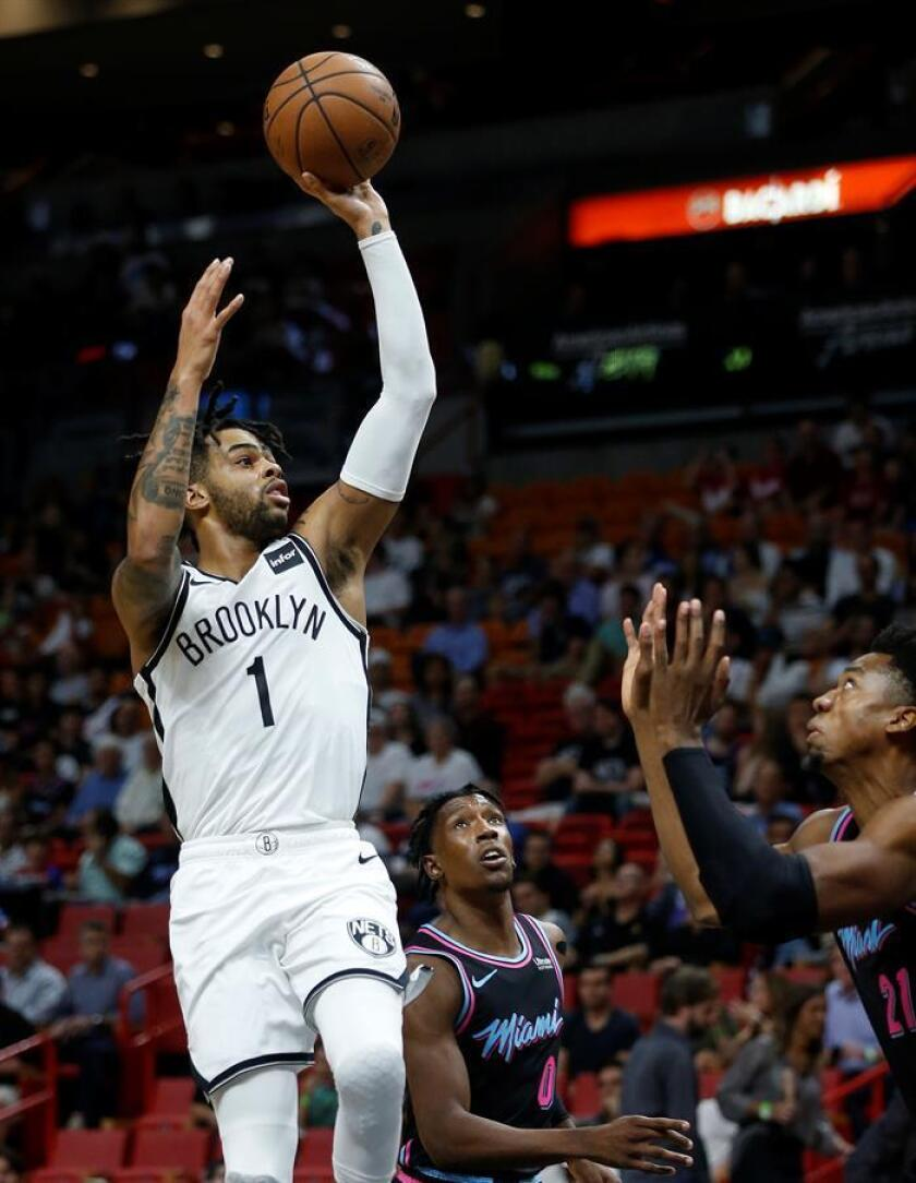 Brooklyn Nets guard D'Angelo Russell (L) shoots over Miami Heat forward Josh Richardson (C) and center Hassan Whiteside (R) during their game at the American Airlines Arena in Miami, Florida, USA, 20 November 2018. EPA-EFE/RHONA WISE