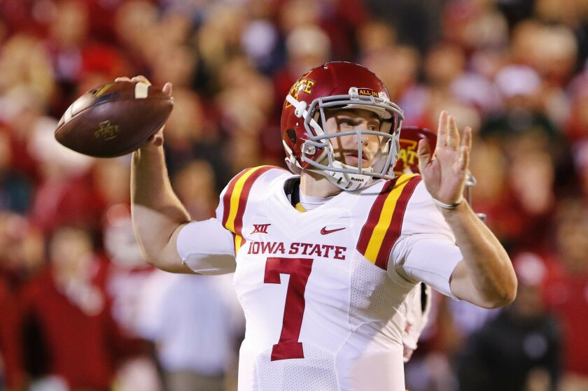 Iowa State quarterback Joel Lanning passes against Oklahoma during the first quarter of an NCAA college football game in Norman, Okla., on Saturday, Nov. 7, 2015. (AP Photo/Alonzo Adams)