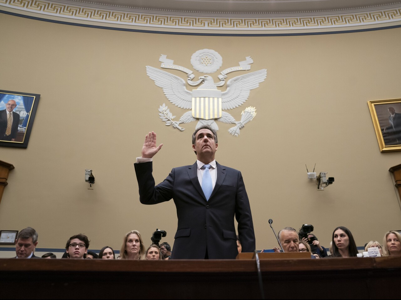 Michael Cohen, President Donald Trump's former personal lawyer, is sworn in to testify on Capitol Hill in Washington.