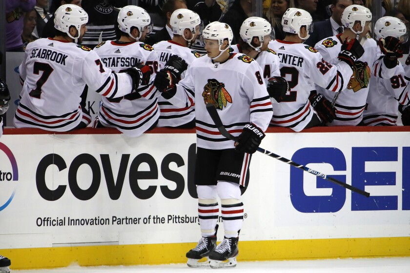 Chicago Blackhawks' Dominik Kubalik (8) returns to the bench after scoring during the second period of an NHL hockey game against the Pittsburgh Penguins in Pittsburgh, Saturday, Nov. 9, 2019. (AP Photo/Gene J. Puskar)