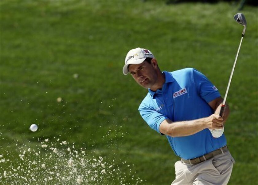 Padraig Harrington, of Ireland, chips onto the 14th green during a practice round for the Masters golf tournament Wednesday, April 4, 2012, in Augusta, Ga. (AP Photo/David J. Phillip)