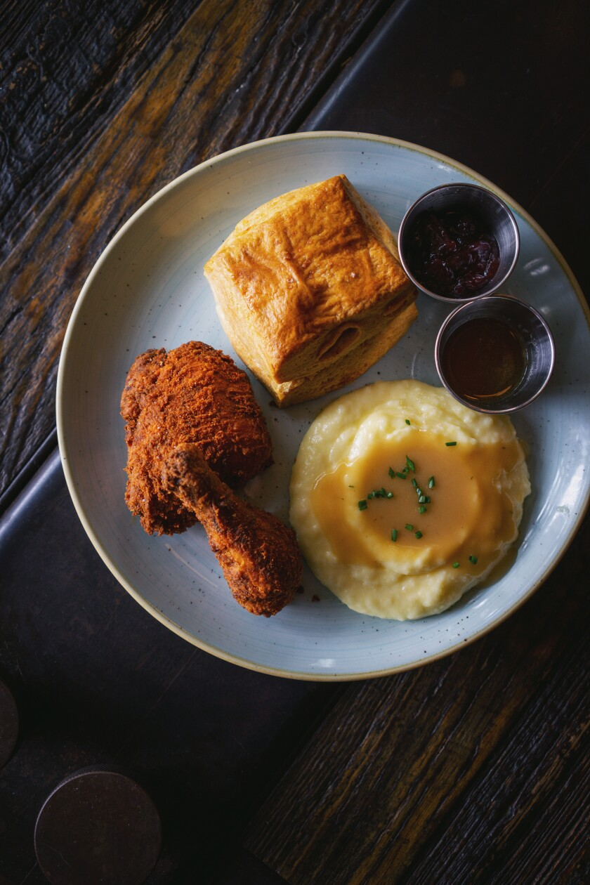 A photo of the two-piece fried chicken combo meal from Craft & Commerce