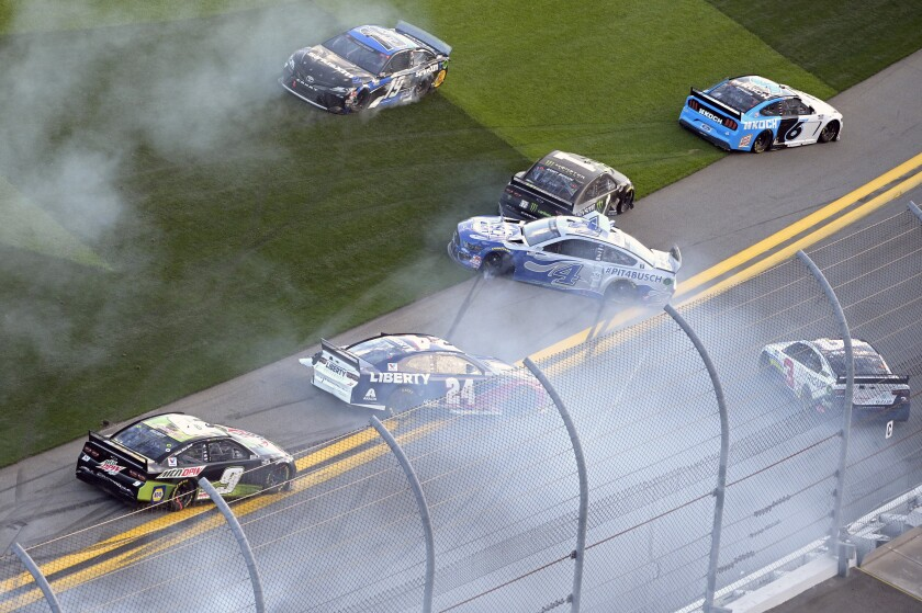 William Byron (24), Martin Truex Jr. (19), Kurt Busch (1), Austin Dillon (3), Ryan Newman (6) and Kevin Harvick (4) are involved in a multi-car accident along the front stretch after a restart from an earlier accident during the NASCAR Daytona Clash auto race at Daytona International Speedway, Sunday, Feb. 9, 2020, in Daytona Beach, Fla. (AP Photo/Phelan M. Ebenhack)