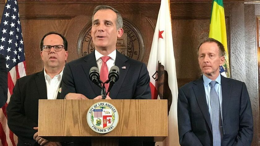 L.A. Mayor Eric Garcetti, center, speaks Tuesday after a contract agreement was reached between the L.A. teachers union and the school district. Behind him are union President Alex Caputo-Pearl, left, and L.A. Unified Supt. Austin Beutner.