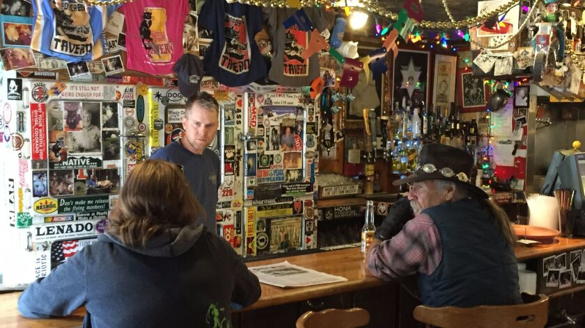 Bartender Eric Kincade talks to regulars the Woody Creek Tavern near Aspen. The bar was a longtime h