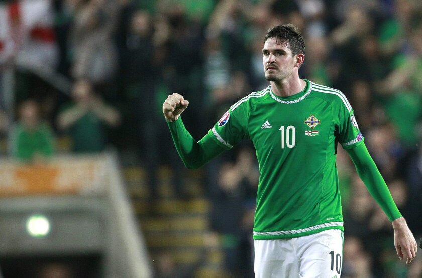 FILE - In this Monday, Sept. 7, 2015 file photo, Northern Ireland's Kyle Lafferty celebrates at full time following his goal against Hungary during their Euro 2016 Group F qualifying soccer match at Windsor Park, Belfast, Northern Ireland. (AP Photo/Peter Morrison, File)