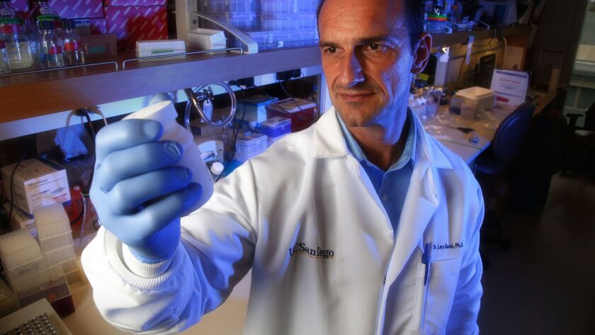At his lab in the Biomedical Research Facility on UCSD, Lars Bode, associate professor in pediatrics at UCSD holds a sample of breast milk.