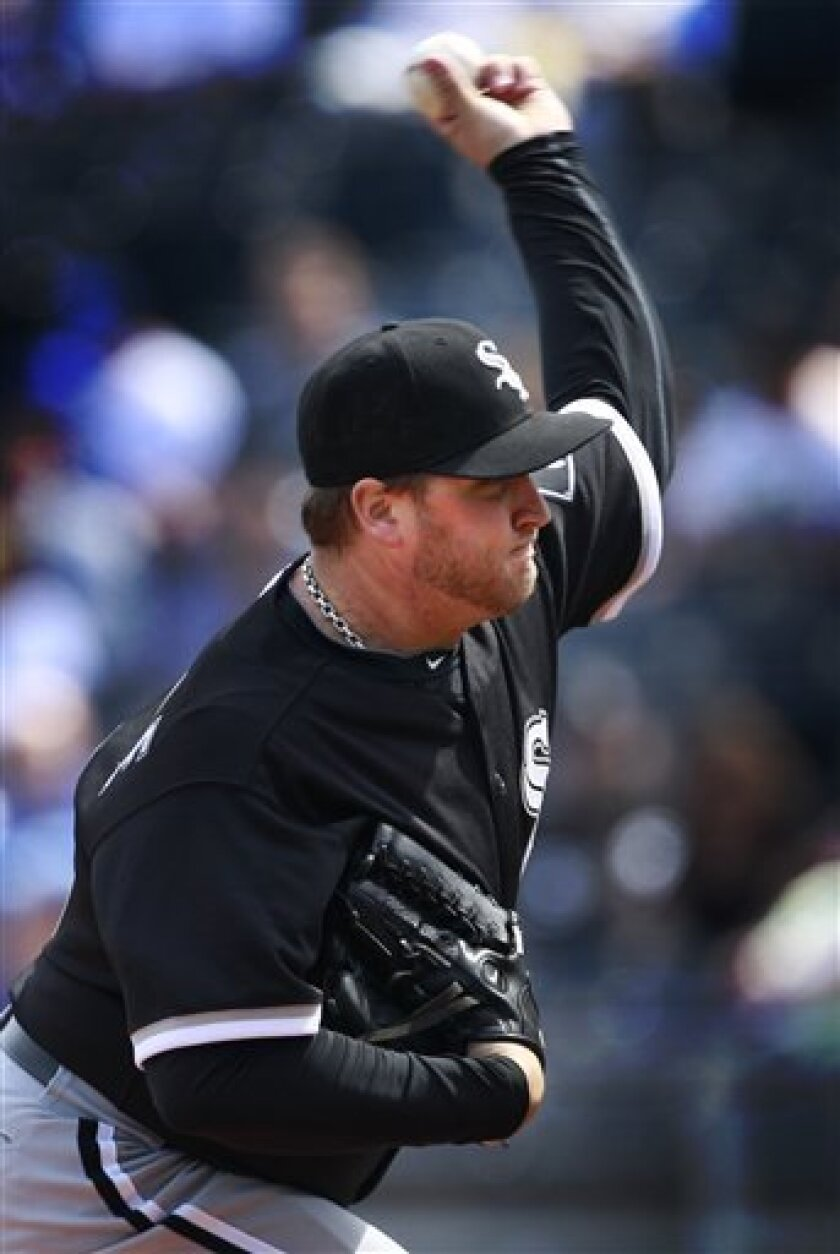 Chicago White Sox starting pitcher Mark Buehrle pitches to Kansas City Royals batter Mike Aviles during the first inning of a baseball game in Kansas City, Mo., Wednesday, April 6, 2011. (AP Photo/Orlin Wagner)