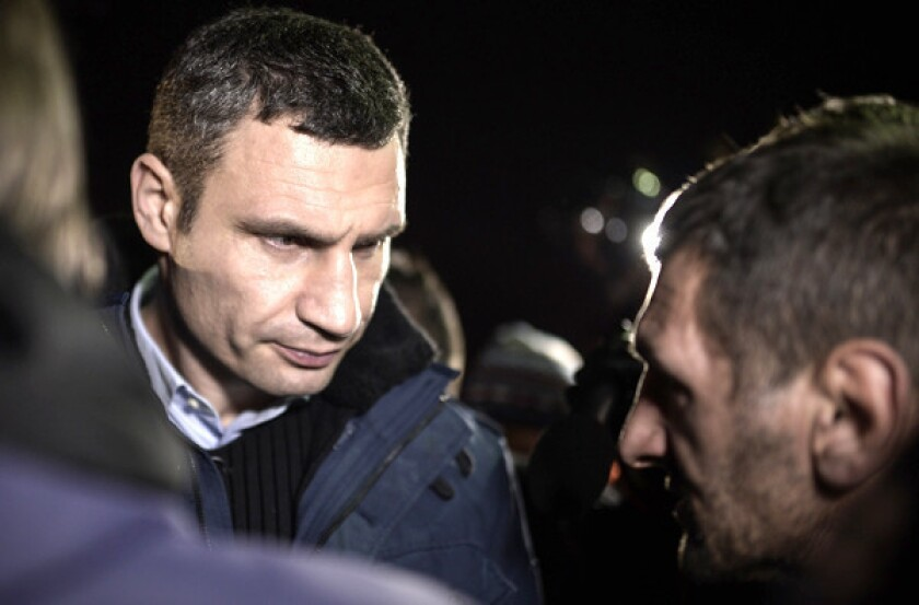 Vitali Klitschko speaks to anti-government protesters at Independence Square in Kiev, Ukraine, on Friday.