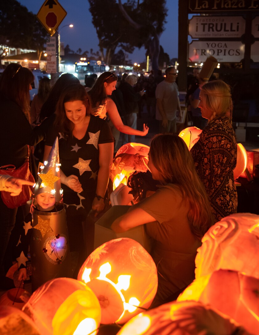 """Thousands of costumed trick-or-treaters will stroll up and down """"Pumpkin Lane,"""" aka South Coast Hwy 101, from Encinitas Blvd to K Street, on Oct. 31."""