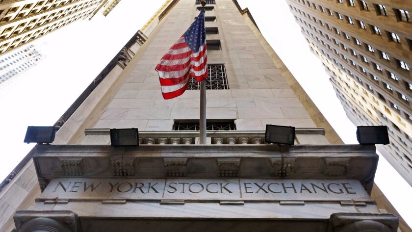 FILE - In this Friday, Nov. 13, 2015, file photo, the American flag flies above the Wall Street entr