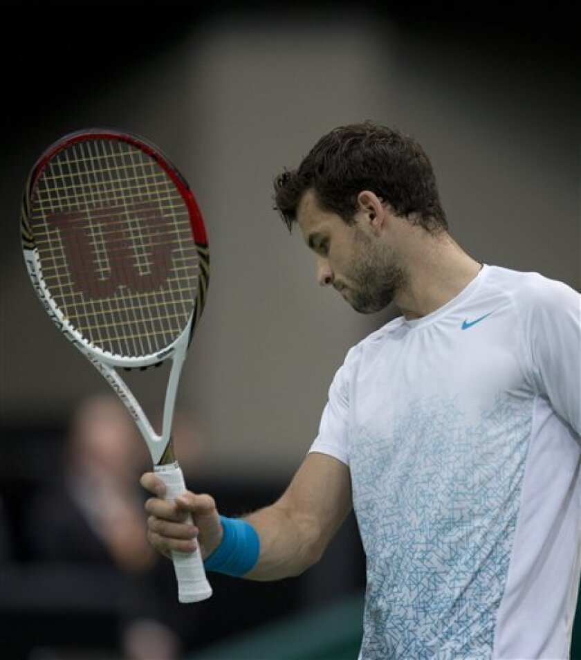 Grigor Dimitrov of Bulgaria reacts after missing a shot against Argentina's Juan Martin del Potro during the semi final match at the ABN AMRO world tennis tournament at Ahoy Arena in Rotterdam, Netherlands, Saturday Feb. 16, 2013. Del Potro won in two sets 6-4, 6-4. (AP Photo/Peter Dejong)
