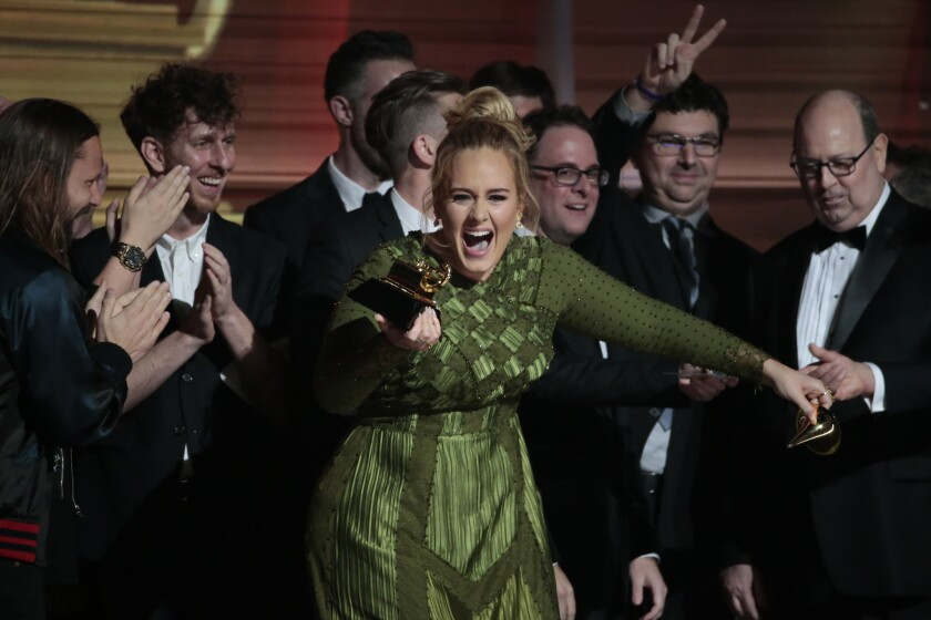 """Adele reacts to winning the award for song of the year for """"Hello."""" She also won record of the year."""