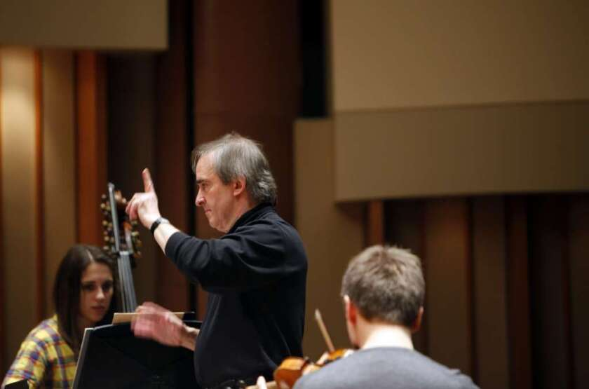 Conductor James Conlon, music director of Los Angeles Opera, leading students at the Colburn School in 2012.