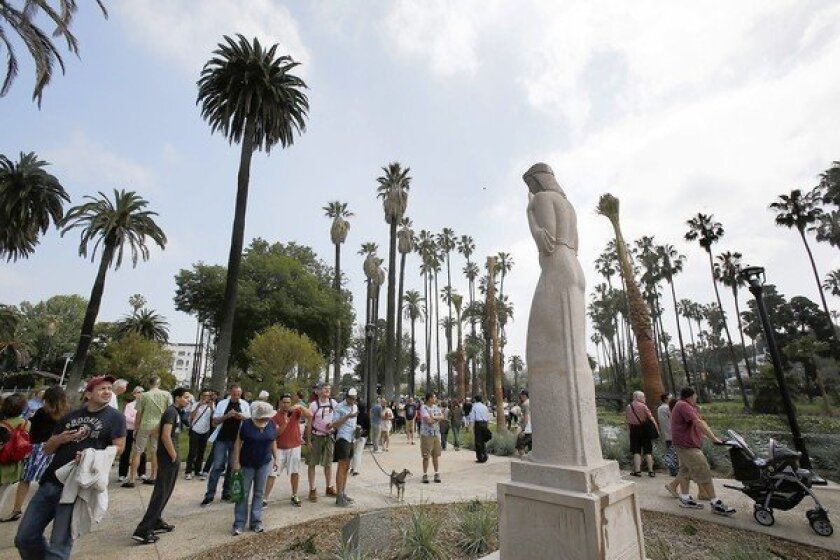Bringing strollers and dogs, people visit the newly refurbished Echo Park Lake.