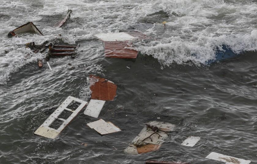 Debris is littered along the shoreline off Cabrillo Monument
