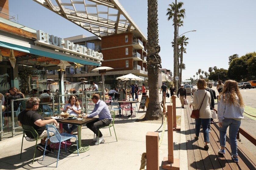 SANTA MONIA, CA - MARCH 29: People dining at Blue Plate Taco in Santa Monica as people take advantage of the warm weather during the COVID-19 Spring break in Southern California Monday. Santa Monica Pier and Promenade on Monday, March 29, 2021 in Santa Monia, CA. (Al Seib / Los Angeles Times).