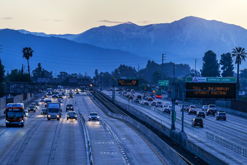 "On the first day of Los Angeles County's ""Safer at Home"" order, traffic is light on Interstate 10."