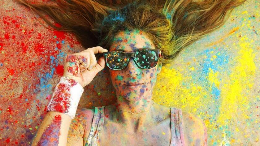 Nicole Zuelke prepares for a color run in Mission Bay. (K.C. Alfred)