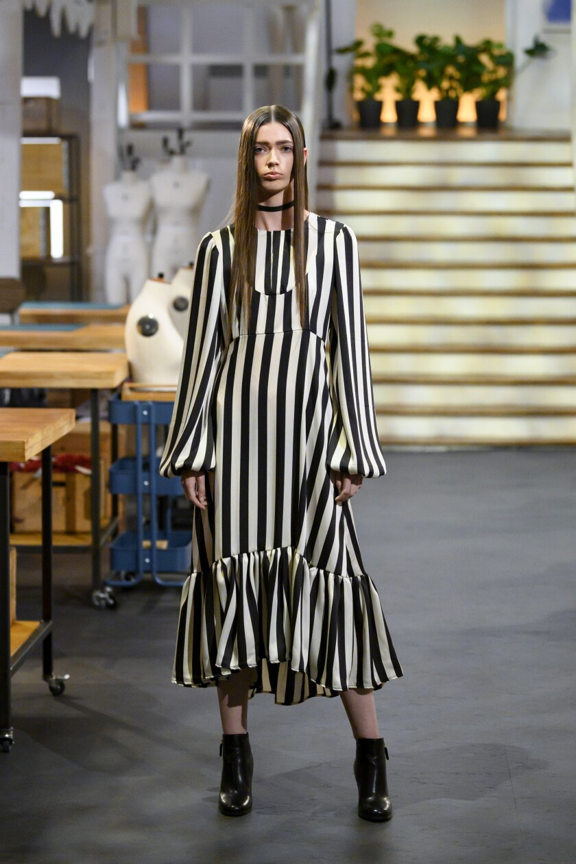 Beetlejuice might call this the midi dress to die for.