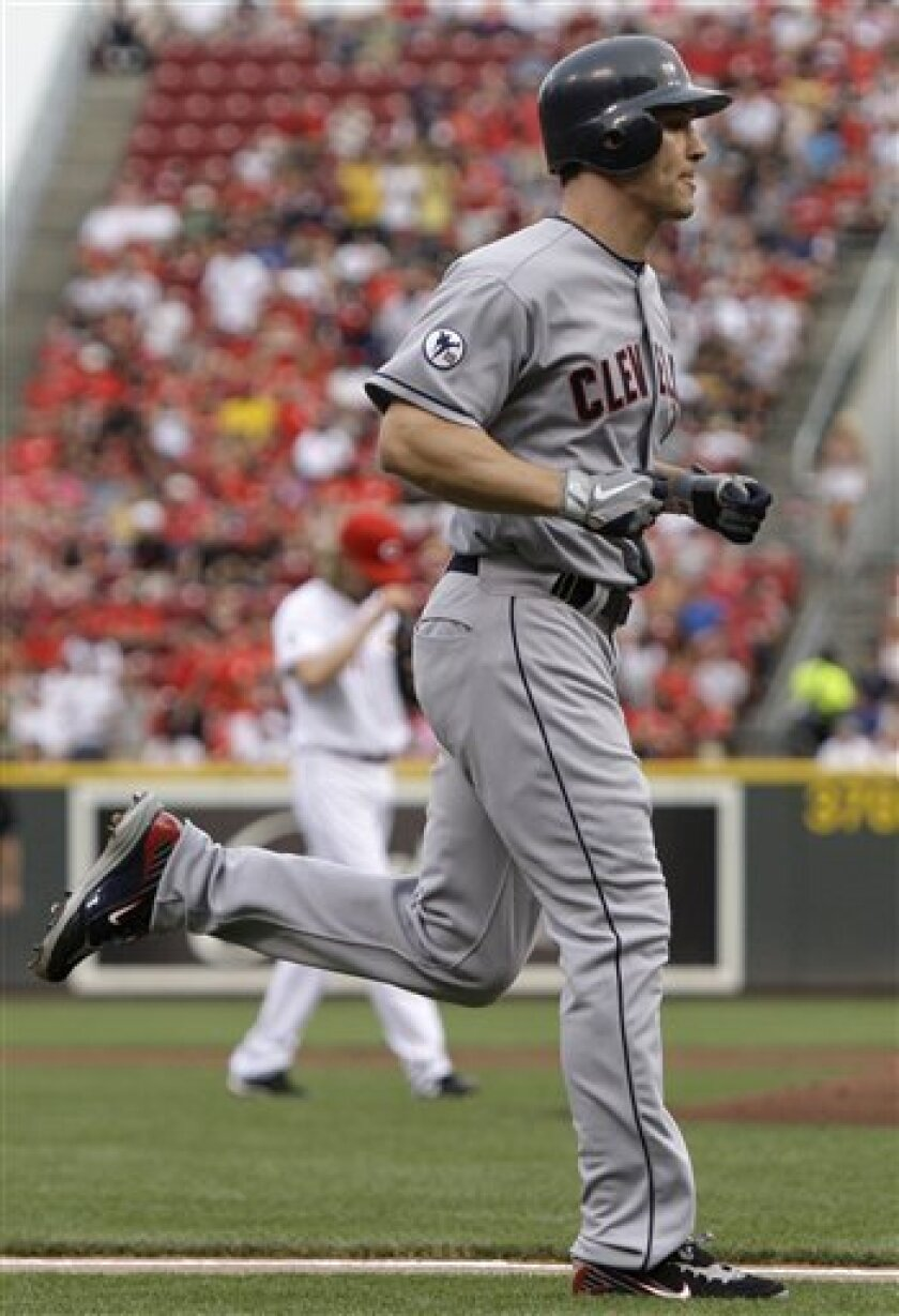 Cleveland Indians' Grady Sizemore, foreground, rounds the bases after hitting a solo home run off Cincinnati Reds starting pitcher Bronson Arroyo, background left, in the second inning of an interleague baseball game on Friday, July 1, 2011, in Cincinnati. (AP Photo/Al Behrman)
