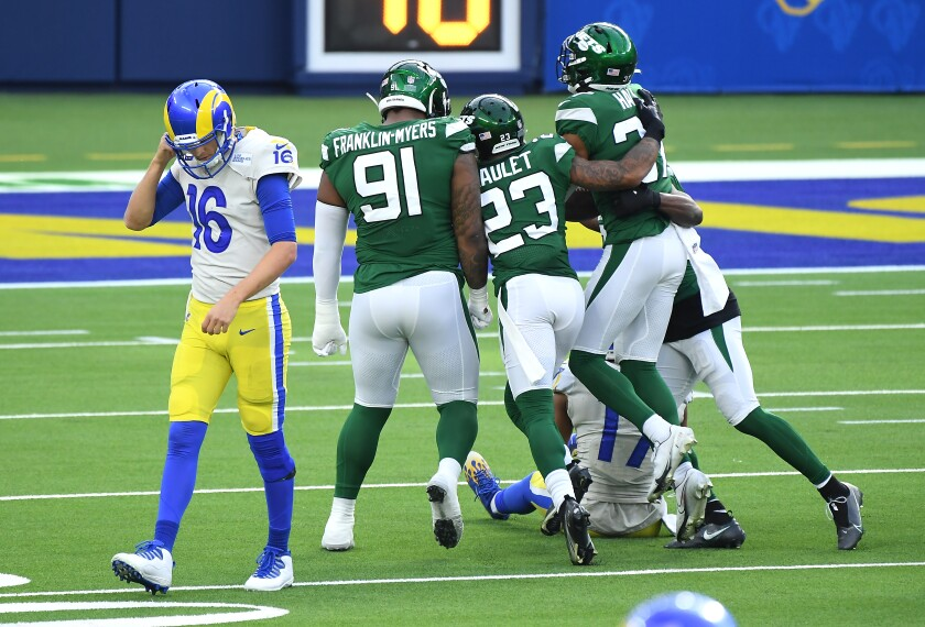 Rams quarterback Jared Goff walks off the field after throwing an interception against the Jets.