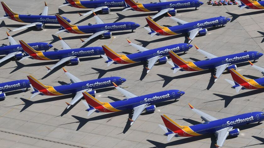 Southwest Airlines Boeing 737 Max aircraft are parked on the tarmac at the Southern California Logistics Airport in Victorville after being grounded.