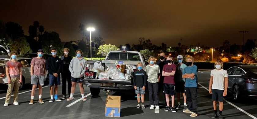 Hundreds of community members participated in a drive-thru stuffed animal collection