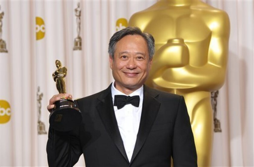 """Ang Lee poses with his award for best directing for """"Life of Pi"""" during the Oscars at the Dolby Theatre on Sunday Feb. 24, 2013, in Los Angeles. (Photo by John Shearer/Invision/AP)"""