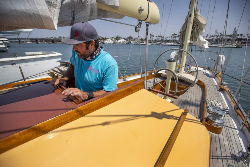 Ben Wheatley, head rigger with Bahia Marine, goes below deck aboard a 67' sailboat in Alamitos Bay Marina.