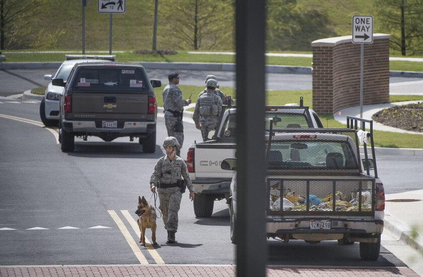 Security personnel patrol outside the Malcolm Grow Medical facility on Andrews AFB in Morningside, Md., when the base was placed on lockdown about 9 a.m. after an active shooter was reported, Thursday, June 30, 2016. Officials say reports of an active shooter at the military post stemmed from someo