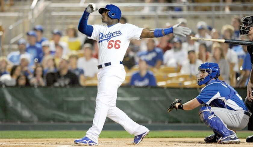 Yasiel Puig went 3 for 3 from the plate with a two-run home run during the Dodgers' 8-1 blowout of the Kansas City Royals.