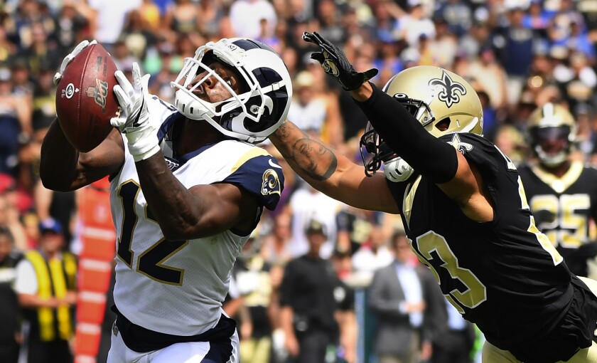 Brandin Cooks hauls in a 57-yard pass in front of New Orleans cornerback Marshon Lattimore in September.