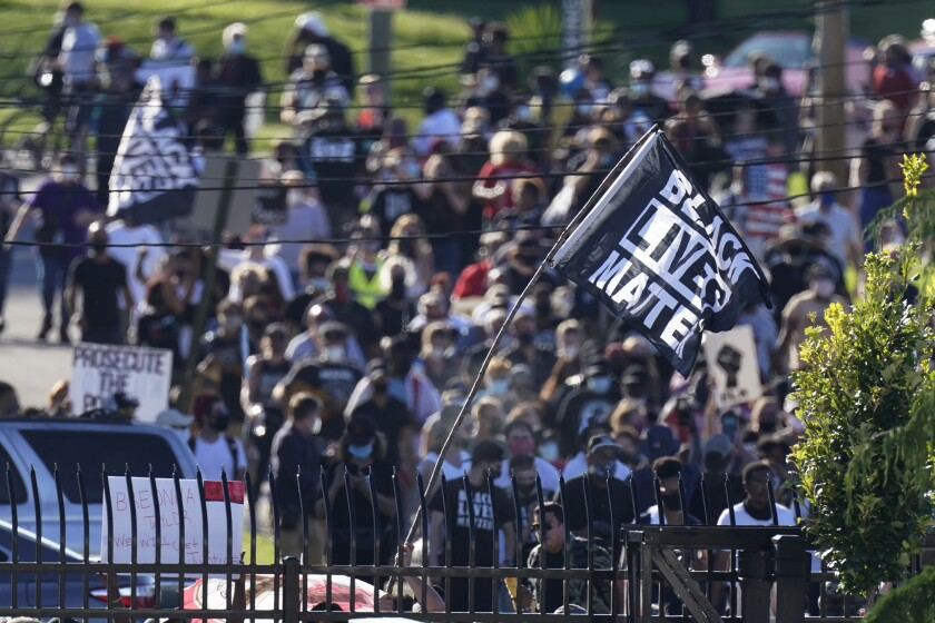 Protesters march past the Churchill Downs racetrack before the Kentucky Derby in Louisville.